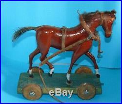2 chevaux en bois elegant sculptes sur plateforme & roulettes jouet ancien