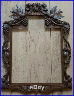 Ancien cadre en bois sculpté daté 1915 travail de poilu art populaire Alsace
