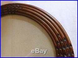 Ancien cadre ovale bois sculpté d'époque art déco avec son verre