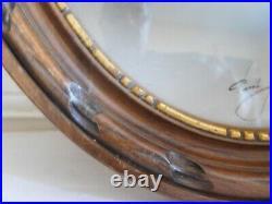 Ancien cadre ovale bois sculpté et dorure d'époque art déco avec son verre