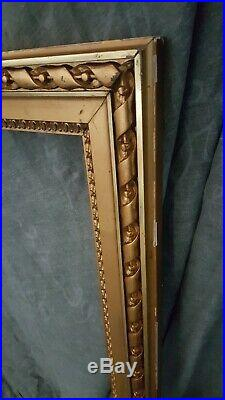 Ancien grand cadre en bois stuc doré décor flot fin XIXème 105x83cm 3,4kg