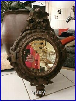 Ancien miroir de style Louis XVI en bois sculpté