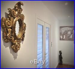 Ancien miroir ovale 18ème en bois sculpté et stuqué doré rocaille Louis XV