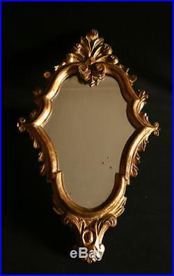 Ancien petit miroir murale en bois sculpté doré décors fleur de Lys, XIX ème