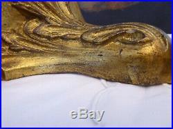 Ancienne paire de console d'applique en bois doré sculpté