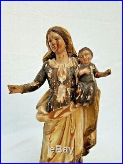 Ancienne vierge à l'enfant en bois sculpté
