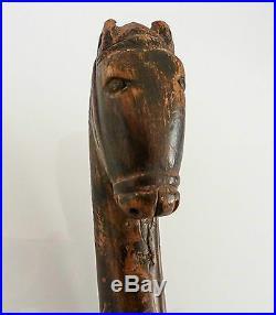 Asie bâton ancien avec pommeau sculpté d'une tête de cheval