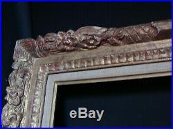 Cadre bois sculpté doré ancien