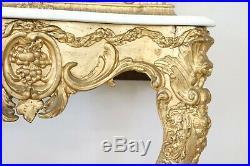 Console ancienne en bois sculpté et doré de la fin du XIXème siècle