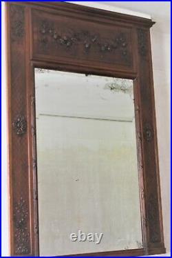 Grand miroir ancien dit trumeau avec cadre en bois sculpté