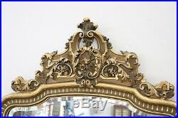 Grand miroir ancien en bois sculpté et doré du 19ème siècle