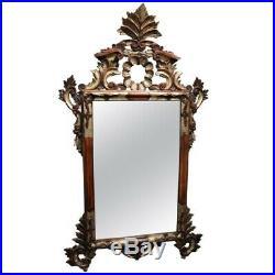 Miroir ancien de style Louis XV en bois sculpté et feuille d'argent doré