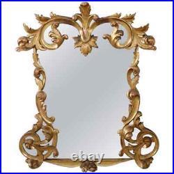 Miroir ancien en bois sculpté doré à la feuille d'or 19ème siècle