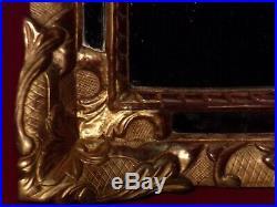 Miroir ancien en bois sculpté et doré feuille d'or d'époque Régence 18ème siècle