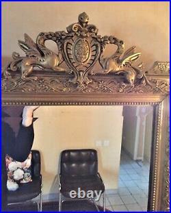 Miroir ancien sculpté en bois et stuc doré