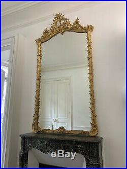 Très Rare Grand Ancien miroir doré Louis XV sculpté feuilles Palmier Coquille