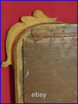 XVIII ème s, miroir ancien en bois en sculpté doré